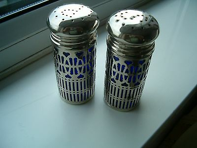 Pair of deep blue lined vintage salt and pepper clad in silver metal.
