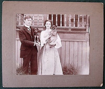 Couple Holding Their Dogs - antique cabinet photograph