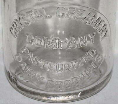Vintage milk bottle CRYSTAL CREAMERY COMPANY DAIRY PRODUCTS embossed half pint
