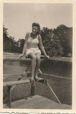 Vintage Photo woman with pretty smile poses by the water  #663