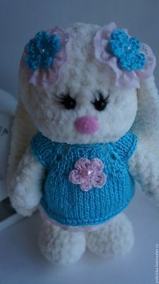 Author's handmade toy, knitted toy rabbit.