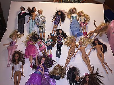 Set Of 16 Barbie Doll Lot With A Pink Case For Travel.