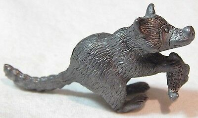 Vintage Miniature Pewter Raccoon Holding Fish Figurine