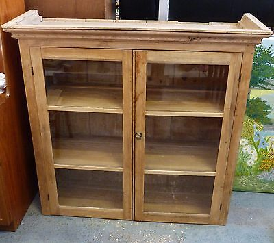 Antique stripped pine and waxed dresser top cupboard with glass doors