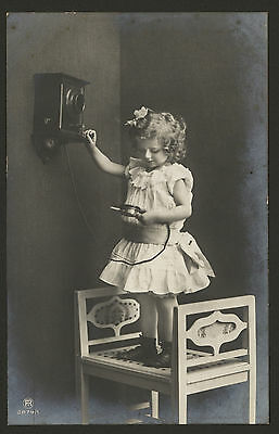 Little Girl Standing on a Stool to Use that New Fangle Telephone! 1911 Postcard