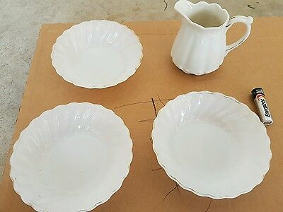 Antique jug and saucers