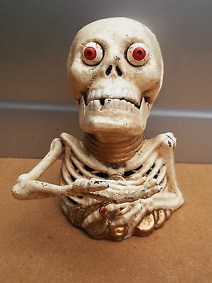 Lovely SKELETON / SKULL Money Box.. hand rises/ eyes pop out to collect money !!