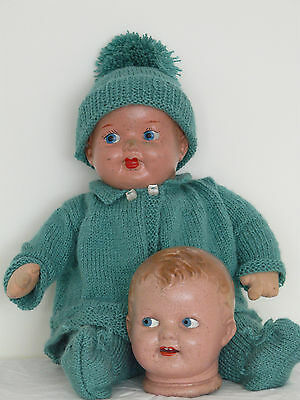 Vintage composition-head Pedigree doll on cloth body, with extra head