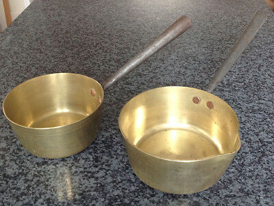 Two antique solid brass saucepans