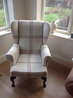 wing backed armchair covered in Laura Ashley fabric