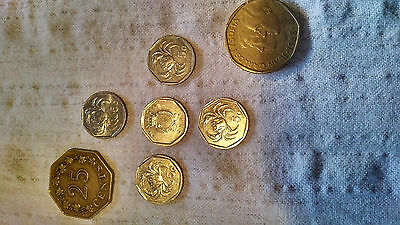 Seven coins from Malta and Spain