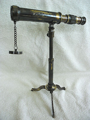BRASS TELESCOPE ON A TRIPOD STAND. ANTIQUE LOOK FINISH. 25cm  New.