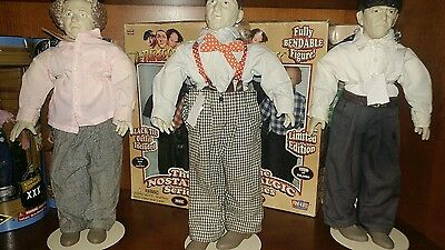 3 Stooges dolls with stands