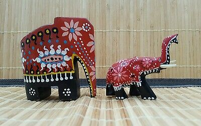 Hand Carved And Painted Elephants.