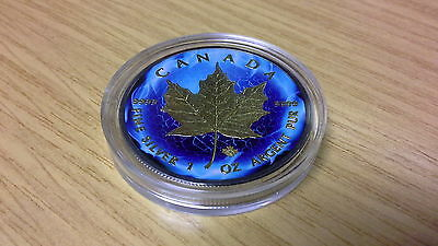 1 oz 999 silver Canadian Maple Leaf. Ruthenium plated and gold gilded.