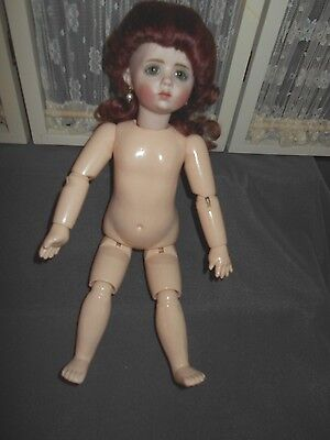 "Bisque & Jointed  Composition 11"" , A Marque Reproduction  Doll"