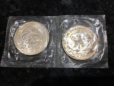 A pair of 1968 Mexico Silver 25 Pesos Olympics Coins