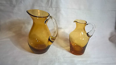 Two Whitefriars style cream jugs.