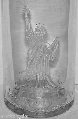 Vintage soda pop bottle LIBERTY BOTTLING CO embossed statue pictured St Louis MO