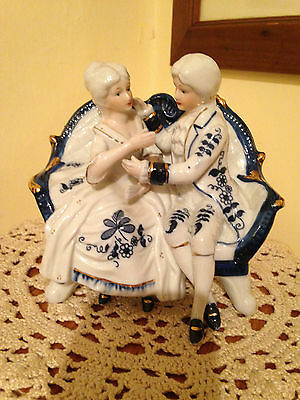 Porcelain Couple Seated on Sofa - In Blue, White