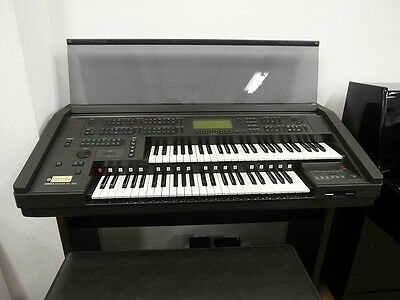 Yamaha EL90 Electone Electronic organ, includes discs, music books and sheets.