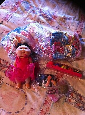 estate lot~ storage unit cleanout (cabbage Patch, Puppets, Phone Covers, Ect)