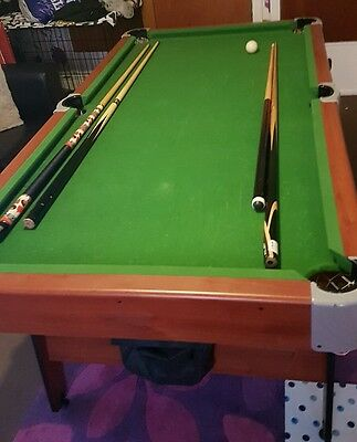 6ft pool table with 2 cues and American pool balls and snooker balls