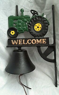 Cast iron tractor wall bell with bracket. New reproduction.