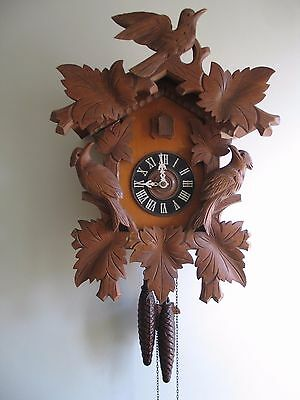 An old large carved  cuckoo clock