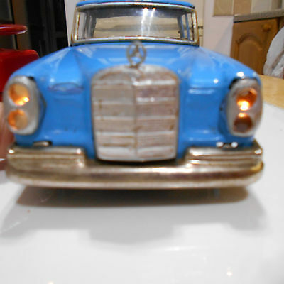 japanese tinplate remote control battery operated mercedes with headlamps 1962?