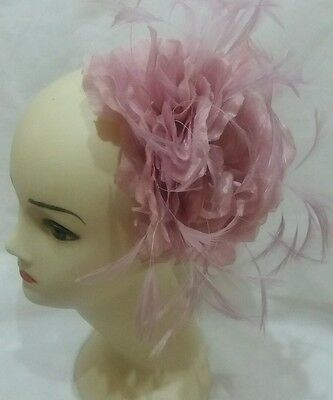 ladies pink fascinator on a hair band wedding races ascot