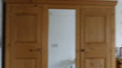Solid wood double wardrobe with centre mirror