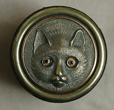 A stunning, characterful and rare Victorian travelling cat face inkwell