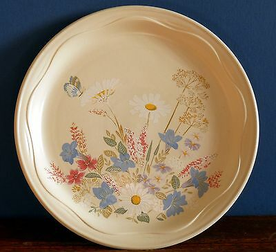 "A 10"" Springtime dinner plate by Poole Pottery"