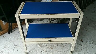 Old transforming/fold up table on casters. Unusual