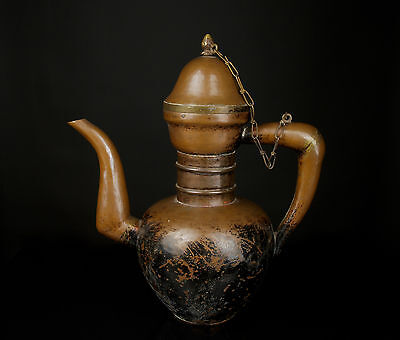 A 19th c. Himalayan Hand Constructed Copper Butter Teapot.