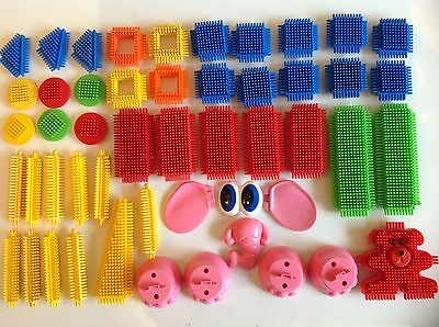 50 Stickle Bricks Of Various Shapes & Sizes Including Elephant Parts as shown.