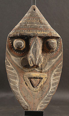 Small Happy Ancestor Spirit Face Washkuk Mountains Of  Papua New Guinea