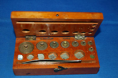 A rare named L. Oertling, London set of brass apothecary weights in mahogany box