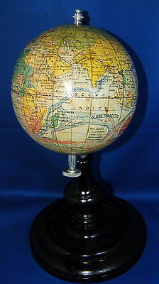 An unusual early twentieth century terrestial globe, black painted wooden stand