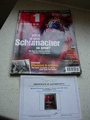 f1 racing magazine,signed, by michael schumacher, with c.o.a