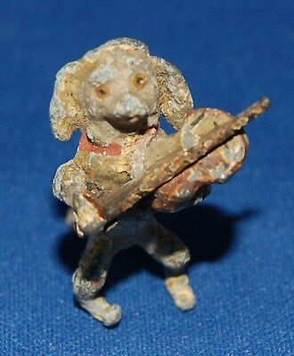 A lovely painted tiny model of a spaniel dog musician playing a violin