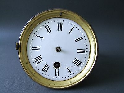 Vintage clock movement with enamel dial for spares or parts