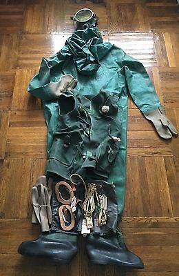 NEW. Rare dry rubber dive suit. Full suit with mask and inflatable rubber vest.
