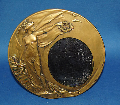 A very attractive antique Art Nouveau brass photo frame with classical maiden