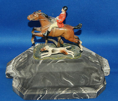 A lovely painted spelter foxhunter, horse and hound group pin dish or pen tray
