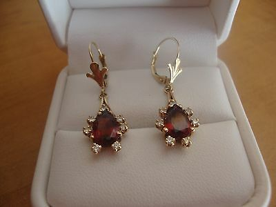 14 kt yellow gold pear shape garnet and round brilliant  diamond earrings