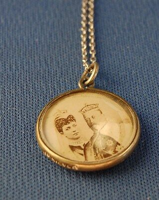 An unusual silver framed pendant featuring King Edward VII and Queen Alexandra