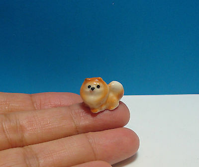 Tiny Pomeranian Dog Miniature Figurine