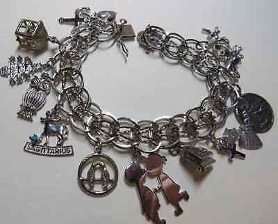 Vintage lovely sterling silver charm bracelet loaded with 13 charms